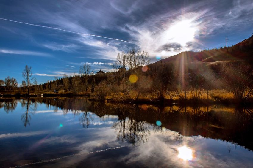 Another sunny day in Steamboat, wandering if the winter skip this town 🤔🤔 Beauty In Nature Water Reflection Cloud - Sky No People Scenics Lake Nature On Your Doorstep Non-urban Scene Connection Nature Photography Earth Experience Early Winter Sunlight Sunset Lovers Lost In The Landscape Lens Flare Exploring Rural Scene DreamScapes