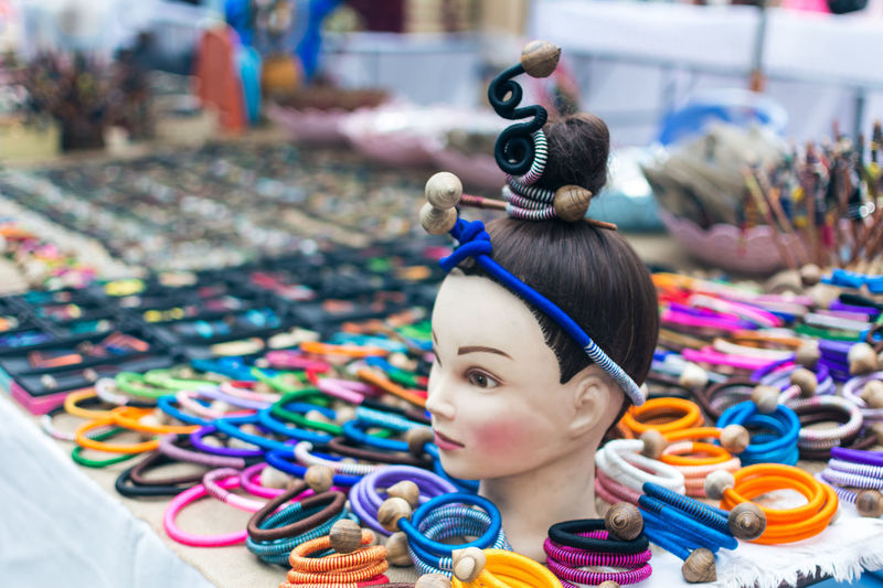 Hair accessories and mannequin at market stall