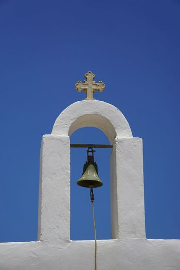 greek church Church Churches Greek Greek Islands Blue Sky Clear Sky Blue Cross Place Of Worship Spirituality Bell Religion Sunny Sky Architecture Whitewashed Cross Shape Historic Crucifix Bell Tower - Tower Orthodox Church Religious Symbol Jesus Christ Christianity Religious Equipment Symbolism