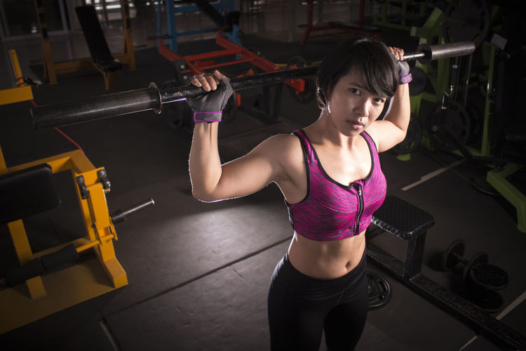 Portrait Of Woman Lifting Weight In Gym