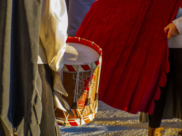 detail of a drum, during a medieval event in Italy Middle Age Sunlight Arts Culture And Entertainment Celebration Clothing Colored Drum Dancing Day Day Light Daylight Drums Festival Focus On Foreground Full Frame Group Of People Lifestyles Medieval Medieval Festival Musical Instrument People Performance Real People Rear View Red Traditional Clothing