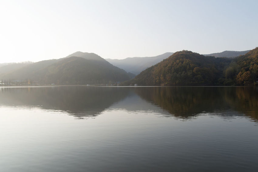 autumn lake of Mungwang Lake in Goesan, Chungbuk, South Korea Fall Beauty Mungwang Lake Autumn Lake Autumn Lakeside Beauty In Nature Clear Sky Day Lake Lake In Autumn Lakeside Mountain Mountain Range Nature No People Outdoors Reflection Scenics Sky Tranquil Scene Tranquility Tree Water Waterfront