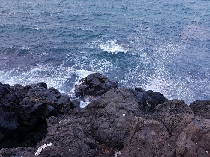 Beauty In Nature Blue Catania, Sicily Day Idyllic Lava And Sea Nature No People Non-urban Scene Outdoors Remote Rippled Rock Rock - Object Rock Formation Scenics Sea Shore Tranquil Scene Tranquility Water Wave Mobile Photography
