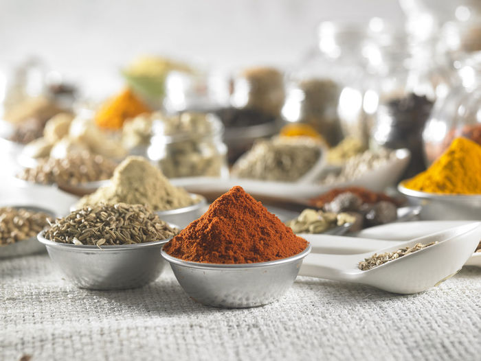 group of spices on the white sackcloth Chili Pepper Choice Food And Drink Freshness Rosemary Spoon Assortment Black Peppercorn Bowl Cardamom Close-up Cumin Food Ground - Culinary Group Of Objects High Angle View Indian Food Ingredient No People Seasoning Spice Still Life Turmeric  Variation Variety