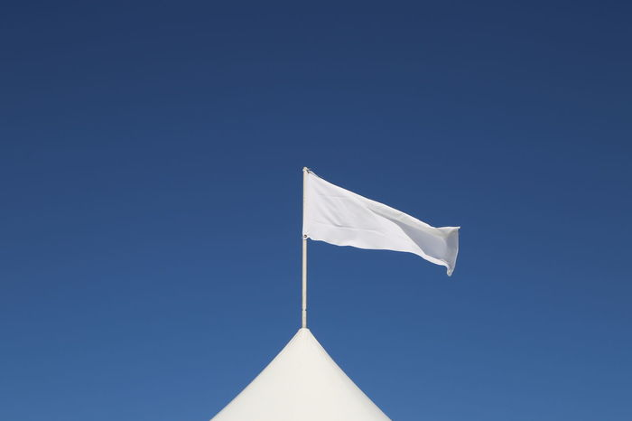 Blue Clear Sky Day Flag No People Outdoors Sky Surrender... Tent Pole White Color White Flag