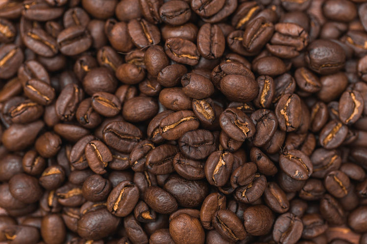 Roasted coffee beans as background Abundance Backgrounds Brown Cappuccino Close-up Coffee - Drink Coffee Bean Coffee Cup Food Food And Drink Freshness Full Frame Group Of Objects Indoors  Large Group Of Objects Mocha Nature No People Raw Coffee Bean Roasted Roasted Coffee Bean Scented
