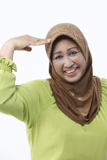 mature malay woman with tudung on white background Asian  Isolated Muslimah Sorry Standing Arms Raised Casual Clothing Cut Out Facial Expression Front View Gesturing Hand Gesture Hand On Head Headwear Malay Ethnicity Mature Adult Mature Women One Person Portrait Real People Scarf Smiling Studio Shot Tudung White Background