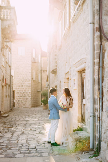 Full length of couple standing amidst alley