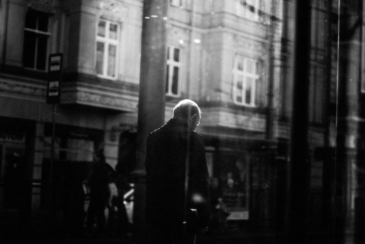 Man seen through window