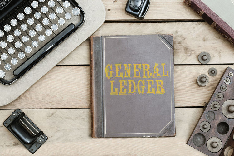 Vintage book General Ledger, accounting and typewriter, weights Accounting Ancient Book Business Finance And Industry Close-up Communication General Ledger No People Old Paper Technology Text Traditional Typewriter Vintage Weights