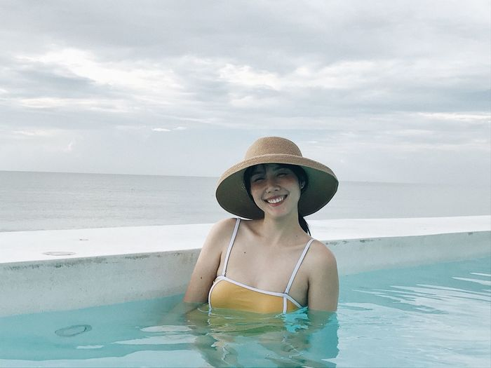 Water Clothing Smiling Sea One Person Sky Trip Happiness Vacations Holiday Cloud - Sky Nature Hat Swimwear Summer Bikini Portrait Swimming Pool Day Sun Hat