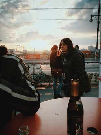 Cheers... Cloud - Sky Togetherness Leisure Activity Young Adult Friendship Outdoors Sunset Warm Clothing Friday Night Urban Lifestyle Urban Skyline Streetphoto_color Streetphotography Streetscene People City Sky Beer Drink Look Looking At Camera The Street Photographer - 2017 EyeEm Awards Berlin Love Stories From The City