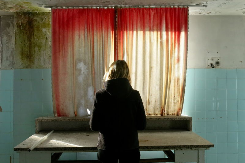 Abandoned & Derelict Abandoned Places Decay Adult Curtain Day Indoors  One Person People Portrait Real People Rear View Standing Women