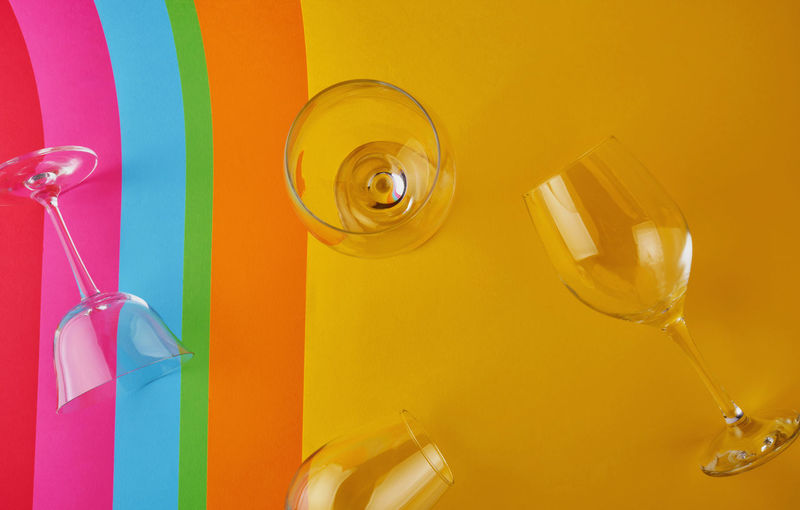 Close-up of yellow wine glass on table