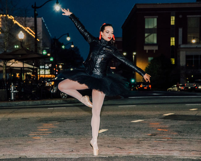 Woman Ballet Dancing On City Street At Night