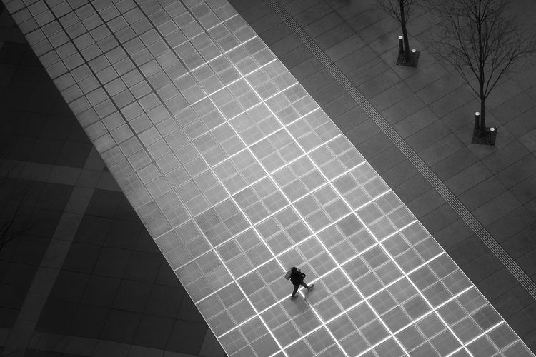 High angle view of man walking by swimming pool