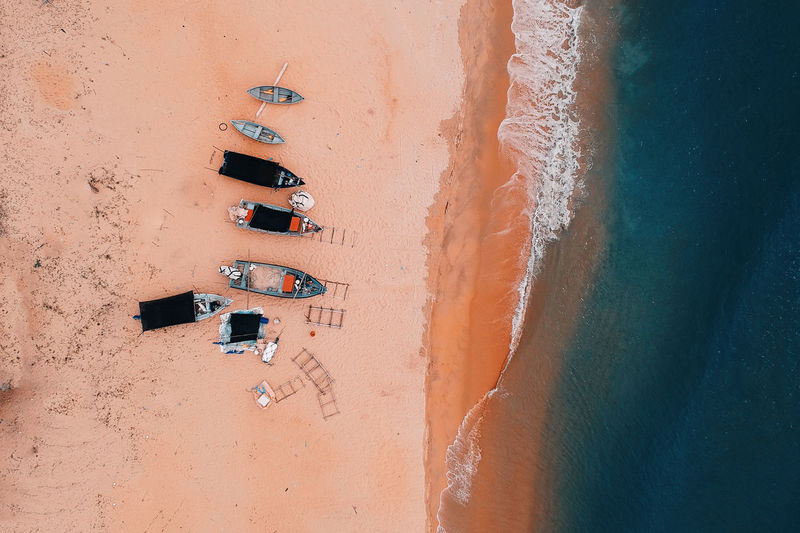 Beach Beauty In Nature Close-up Day Directly Above High Angle View Land Nature No People Orange Color Outdoors Pattern Sand Sea Sport Sunlight Wall - Building Feature Water