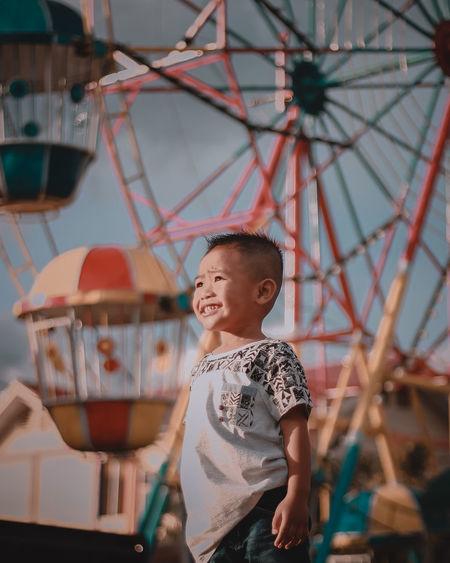 Cute boy looking at amusement park