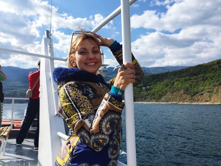 Beautiful Woman EyeEm Selects Sky Cloud - Sky Day One Person Nautical Vessel Real People Smiling Leisure Activity Looking At Camera Outdoors Holding Transportation Happiness Lifestyles Portrait Water Nature Young Women EyeEmNewHere