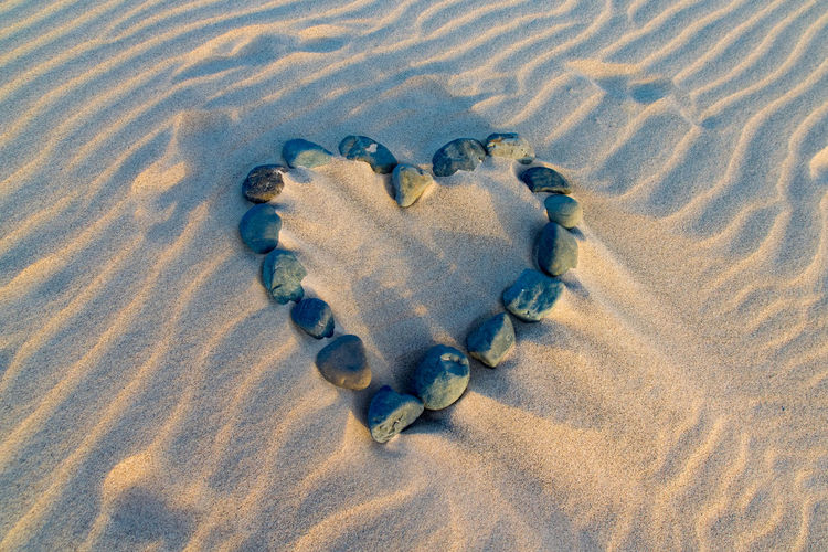 Love heart of stones Love Love Heart Beach Close-up Day FootPrint Heart Heart Shape High Angle View No People Outdoors Sand Sand Dune Stone