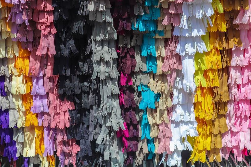 Full frame shot of multi colored umbrellas hanging at store
