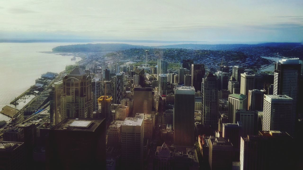 cityscape, city, skyscraper, architecture, building exterior, built structure, skyline, crowded, modern, travel destinations, high angle view, sky, aerial view, outdoors, tall, sea, downtown, growth, day, urban skyline