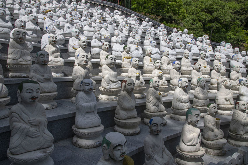View of Bomunsa, a famous Buddhism temple at Seokmodo in Ganghwado, Kimpo, Gyeonggido, South Korea Bomunsa Buddhism Temple Seokmodo South Korea Abundance Arrangement Art And Craft Belief Buddhism Craft Creativity Day Ganghwado High Angle View Human Representation Idol In A Row Large Group Of Objects Male Likeness No People Order Outdoors Religion Representation Sculpture Spirituality Statue Temple