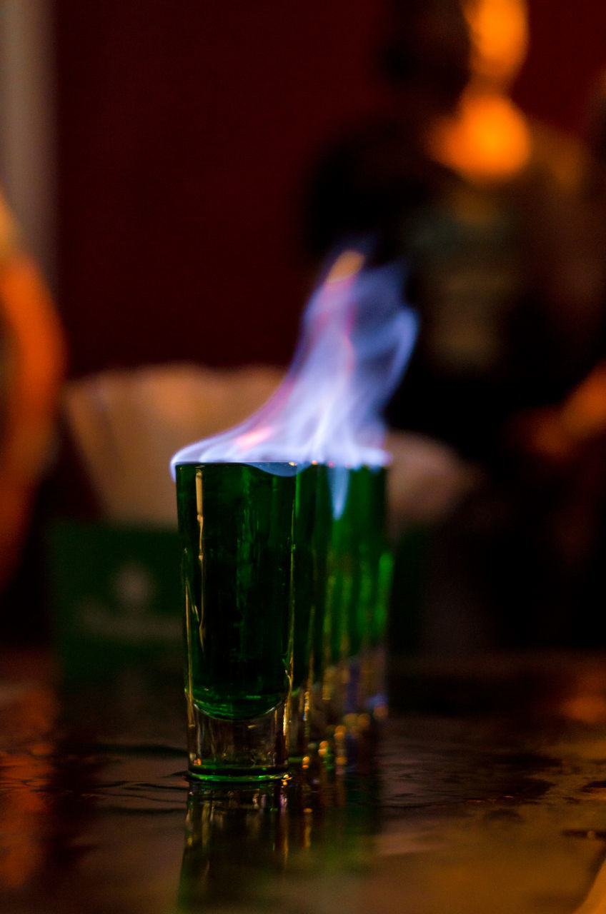 Close-Up Of Fire On Glass At Table