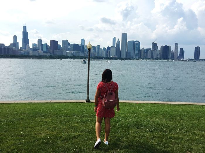 Chicago Building Exterior Built Structure Architecture Rear View One Person City Sky Water Real People Building Leisure Activity Urban Skyline Landscape Cityscape Office Building Exterior Skyscraper Standing Tall - High Lifestyles Women