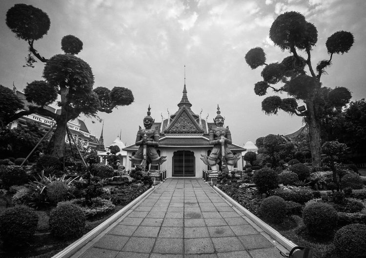 Fisheyey view of the entrance of the ordination chamber at the Wat Arun, Bangkok, Thailand Bangkok Thai Thailand Wat Arun Architecture Belief Building Building Exterior Built Structure Day Outdoors Place Of Worship Religion Sky Spirituality Temple Travel Destinations Tree