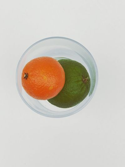 Simplicity of a Lime and Tangerine Pop Of Color Vitamin C NewToEyeEm Citrus Fruit Tangerine Lime Smoothie Close-up Healthy Lifestyle Directly Above Refreshment Food High Angle View Studio Shot No People Still Life Fruit White Background Healthy Eating Freshness Food And Drink