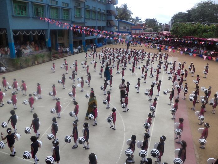 School Children Sports Training Large Group Of People Real People Leisure Activity Building Exterior Outdoors People Architecture Adults Only Ice Rink Parade Military Parade Military Uniform Adult Day Crowd Sports Events Sports Day  Cluny Convent Malleswaram, Bangalore, India