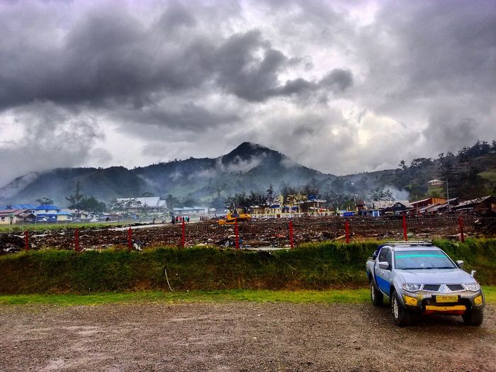 """Misty afternoon view after heavy rain ini Karubaga district Papua, or people there call it """"lembah hitam"""" Agriculture Mountain Field Cloud - Sky Landscape Outdoors Sky Day No People Nature Papua Wonderful Indonesia Inland Travel Journey Photography Landscape_Collection"""