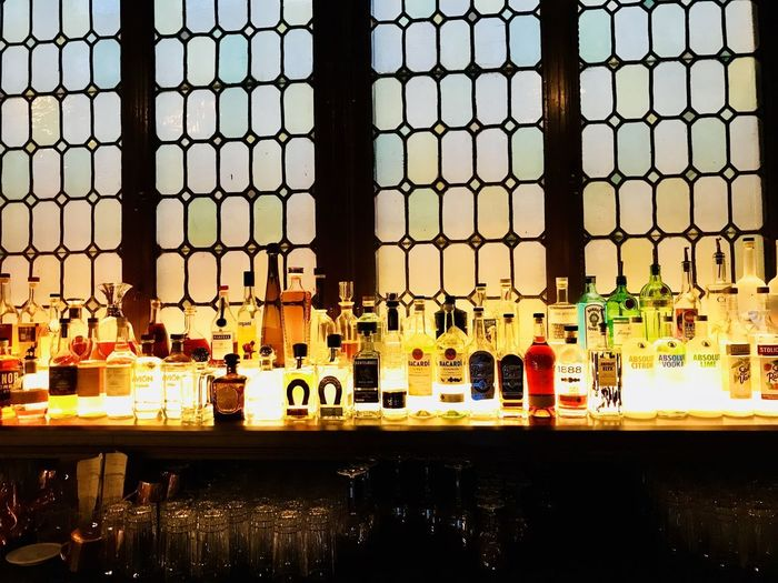Backlit Bar, New York, New York. Bar Counter Bar Countertop Alcohol Bottles Cocktails Classy Bar Backlit Bottles Choice Happy Hour Cocktail Hour Food And Drink Indoors  Refreshment Bar - Drink Establishment Container Bottle Side By Side Large Group Of Objects Alcohol Shelf Glass - Material In A Row Arrangement Drink