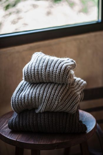 Clothing Hat No People Focus On Foreground Indoors  Close-up Day Table High Angle View Pattern Textile Window Pillow Seat Absence Wool Stack Warm Clothing Personal Accessory Still Life