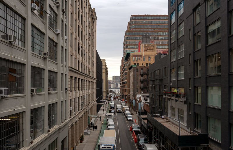 High angle street view, New York 17.62° City Architecture Building Exterior Transportation Built Structure Street Building Road Day Incidental People Residential District City Life Outdoors Apartment New York NYC Down Town Road High Angle View City Cityscapes_collection