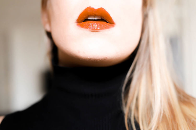 Close-up of young woman with red lipstick