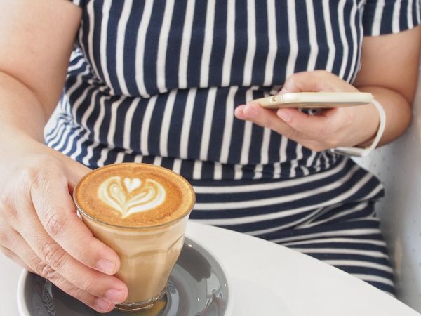 Coffee - Drink Coffee Cup Adults Only Holding Cappuccino Adult Drink Striped Only Women Refreshment Human Body Part Food And Drink Midsection Latte Frothy Drink Cafe People One Person Indoors  Women