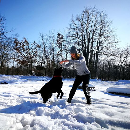 Snowy EyeEmNewHere Togetherness Winter Two People Pets Full Length Child Leisure Activity Cold Temperature Bonding Dog Childhood Day Domestic Animals Snow Outdoors People Adult