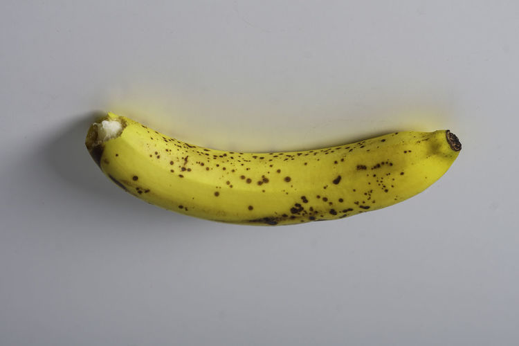 Close-up of bananas against white background