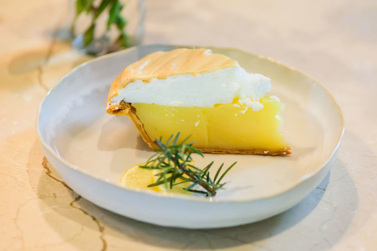Piece of lemon meringue pie on white dish Bakery Cake Citrus  Cream Cuisine Culinary Delicious Dessert Dish Eating Food Fresh Gourmet Juicy Lemon Meringue Pie Piece Sweet Tart Tasty Food And Drink Ready-to-eat Sweet Food Indoors  Serving Size