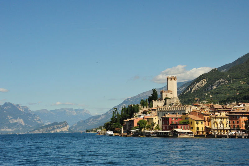 Architecture Blue Sky Building Exterior Castle Day Gardasee House Lake Garda Malcesine Mountain Mountain Range Mountains Sky Town Trees Water Waterfront Waterline Adapted To The City