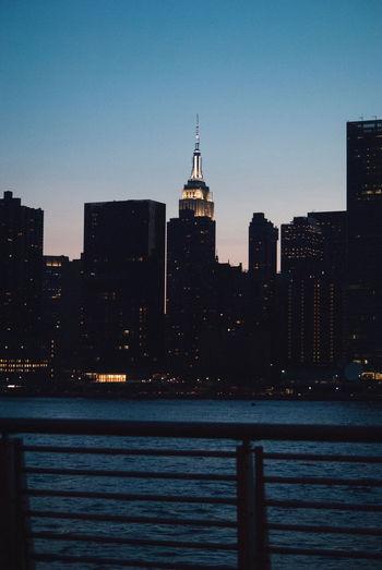 Buildings in city at dusk