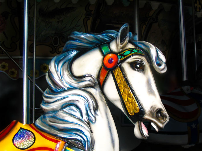 Amusement Park Ride Carousel Horse Circle Close-up Day Fair Low Angle View Merry Go Round Horse Multi Colored No People Outdoors