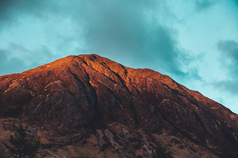 The Pap at Dusk Dusk Scottish Highlands Glencoe Sky Cloud - Sky Mountain Beauty In Nature Scenics - Nature Landscape Environment Nature Geology Tranquility Travel Destinations Mountain Range Dramatic Landscape Outdoors Rock First Eyeem Photo