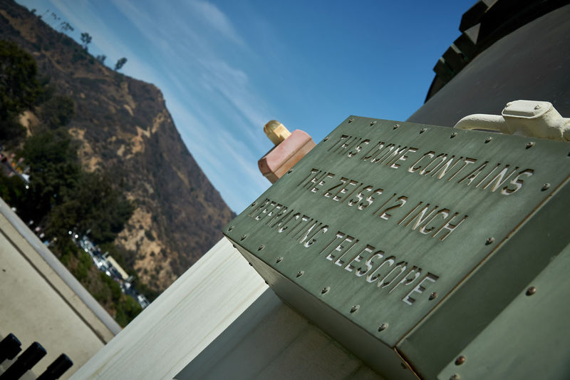 Low angle view of text on mountain against sky
