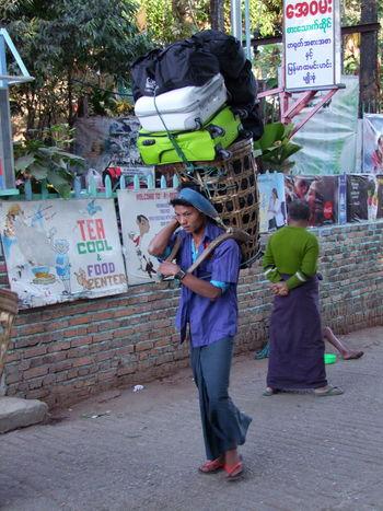 Male Baggage Carrier, Mount Kyaiktiyo Baggage Carrier Full Length Incidental Person Kinpun Loaded Making A Living Man Mount Kyaiktiyo Myanmar One Man Only Shade Standing Street Working
