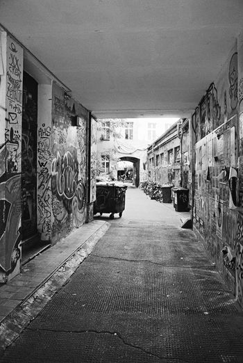 35mm Film Analogue Photography Black & White Buy Film Not Megapixels Nikon FA Architecture Black And White Built Structure Day Doorway Dustbin Graffiti Monochrome Photography No People Schwarzweiß Filmisnotdead Street Photography The Way Forward Waste Container Backyard