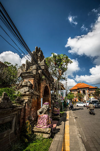Ubud: Palace Front Gate 2 Arch Architecture Blue Building Exterior Built Structure City Cloud Cloud - Sky Cloudy Day Façade Gate Growth Outdoors Plant Residential Building Sky The Way Forward Town Tree The Traveler - 2018 EyeEm Awards