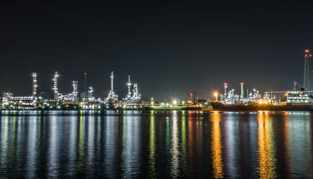 Architecture Built Structure Commercial Dock Factory Freight Transportation Fuel And Power Generation Harbor Illuminated Industry Nautical Vessel Night No People Offshore Platform Oil Industry Oil Refinery Outdoors Refinery Reflection Sea Ship Shipping  Sky Transportation Water Waterfront